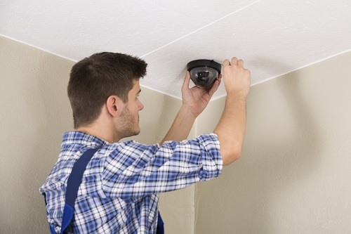 Man Installing Dome IP Camera